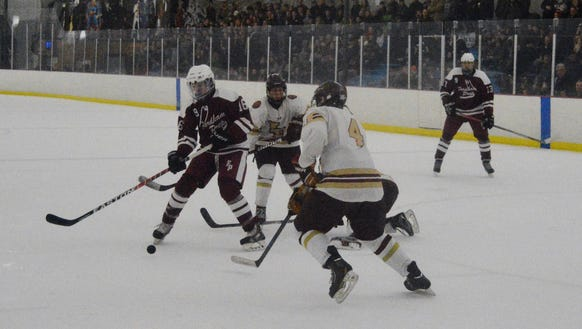 Fordham Prep's Daniel Heslin lets the puck settle then