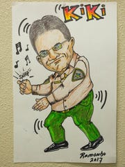 """A caricature of Sheriff Enrique Vigil """"Kiki""""that was drawn by Daniel Ramondo, a Doña Ana County Sheriff's deputy, hangs in Ramondo's office, where the walls are covered in his artwork. Thursday Jan 11, 2018. Vigil has a copy of the artwork."""