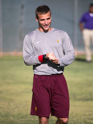 ASU graduate assistant Aaron Pflugrad looks on during spring practice at the Kajikawa practice fields at ASU in Tempe on Thursday, April 3, 2014.