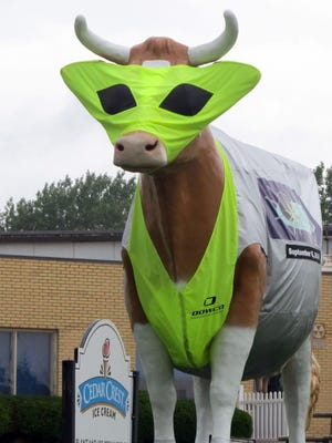"""""""Bessie"""" stands decorated in an alien costume on the front lawn at Cedar Crest Ice Cream's parlor and plant in Manitowoc to promote a previous Sputnikfest."""