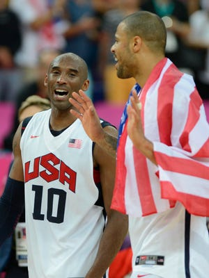 Aug 11, 2012: USA guard Kobe Bryant (10) celebrates with USA center Tyson Chandler (4) after winning the gold in the men's basketball final against Spain in the London 2012 Olympic Games at North Greenwich Arena.