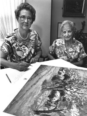 Artist Marilyn Mertz (left) signs prints of one of her photos that were given to contributors to the United Way in 1987. With her is one of the contributors, Mrs. Elmer Dunner.