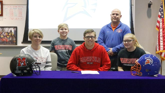 Edison senior Keagan Mawhir signed Friday to play sprint football at Mansfield University. Also pictured are his parents, Mike and Danielle Mawhir, along with Mike's sister, Bailey, and his brother, Mason.