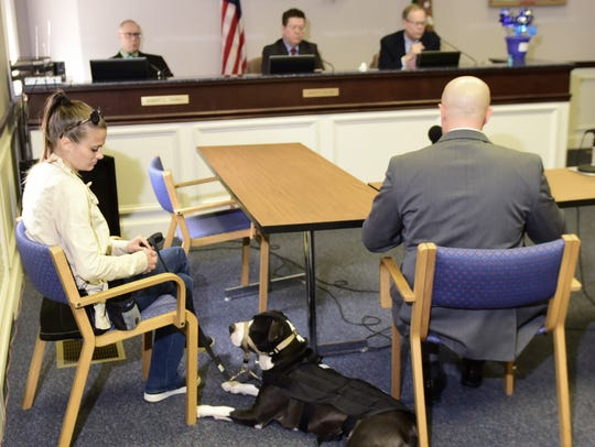 Tracey Kendig, left, sits with Lola on Thursday, April