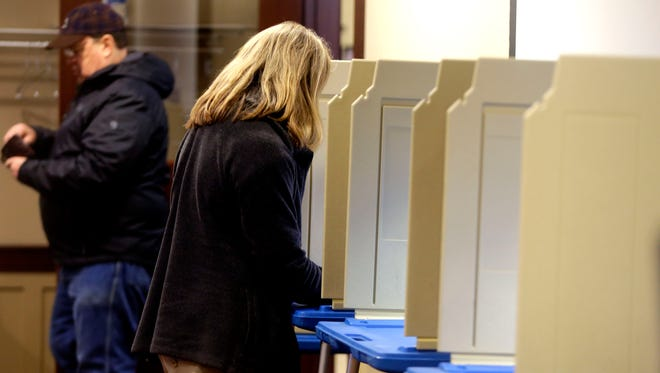 A woman voting in Wauwatosa at the fire station at 1601 Underwood Ave., during the Feb. 20 primary election.