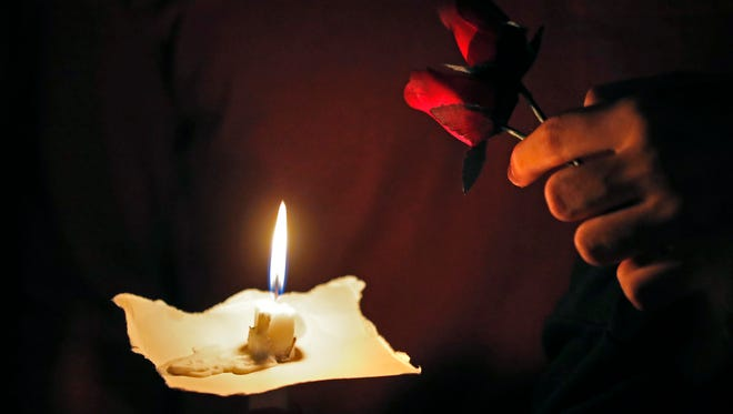 Two roses and a candle