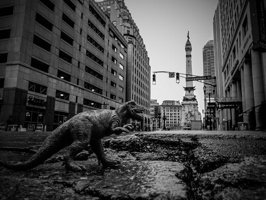 Tyrannosaurus Rex in a pothole at Pennsylvania & Market