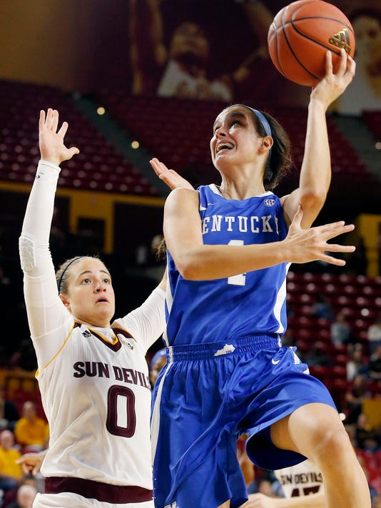FILE - This Nov. 15, 2015 file photo shows Kentucky's Maci Morris, right, trying to get off a shot as Arizona State's Katie Hempen (0) defends during the first half of an NCAA college basketball game in Tempe, Ariz. Morris thought she would spend most of her freshman season at Kentucky settling in, getting used to big-time college basketball. Instead, she has become a significant contributor for the ninth-ranked Wildcats. On Thursday, Jan. 14, 2016 she'll play in the biggest game of her brief college career against No. 2 South Carolina. (AP Photo/Ross D. Franklin, file)