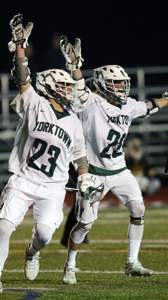 From left, Yorktown's Hunter Embury (23) and Shane