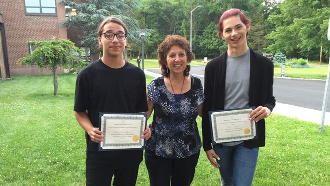 2018 Carol Levasseur Memorial Scholarship recipients Anthony Quinones (left) and Dustin Alfrey (right), at the SCVTHS annual Scholarship Awards Ceremony with scholarship founder Sharleen Leahey (center).