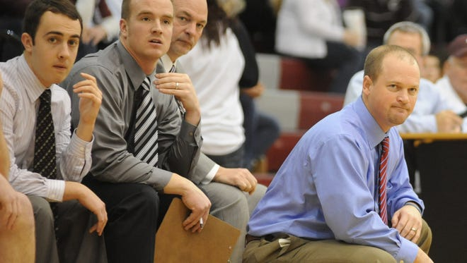 T.J. Mitchell, second from left, was an assistant for 11 years under former John Glenn head coach Greg Woodard, right, during one of the most successful coaching tenures in Muskingum Valley League history. Mitchell was approved as the school's new head coach on Thursday, the school announced.