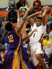 Blackman's Cedriontis Wilson (1) passes the ball as