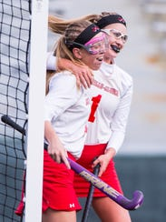 Annville-Cleona Michaela Singer, left, celebrates with