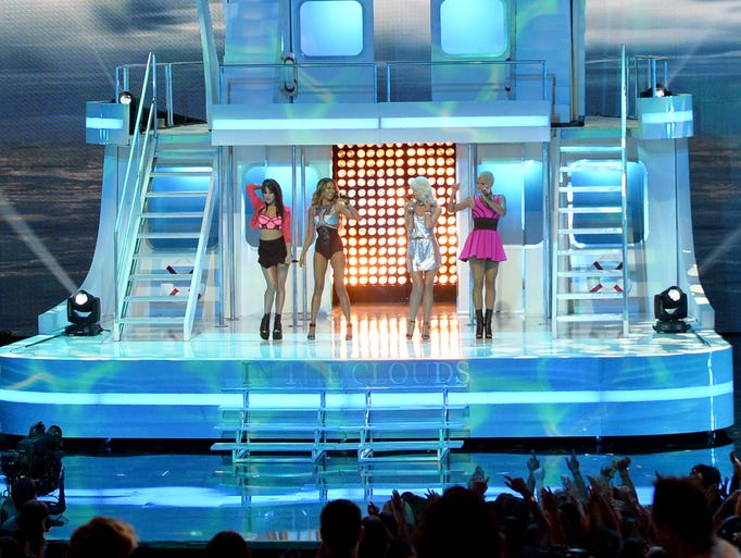 Singers Natasha Slayton, Emmalyn Estrada, Lauren Bennett and Paula Van Oppen of G.R.L. perform onstage during the 2014 iHeartRadio Music Awards held at The Shrine Auditorium on May 1, 2014, in Los Angeles.