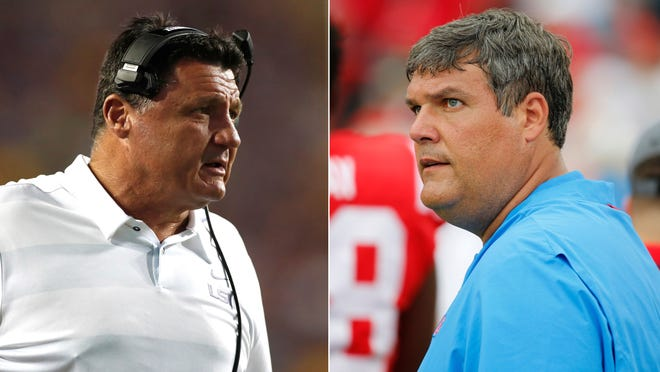 FILE - At left, in a Sept. 22, 2018, file photo, LSU head coach Ed Orgeron looks on from the sideline in the first half of an NCAA college football game against Louisiana Tech, in Baton Rouge, La. At right, also in a Sept. 22, 2018, file photo, Mississippi head coach Matt Luke looks at the scoreboard during the second half of the NCAA college football game against Kent State, in Oxford, Miss. LSU coach Ed Orgeron previously coached at Ole Miss and says the Tigers' historical rival poses a challenge with its explosive offense. Luke is a former Orgeron assistant at Ole Miss. (AP Photo/File)