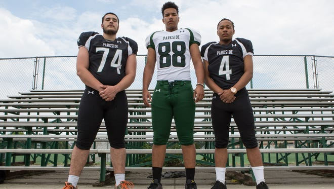 From left, Parkside High School seniors, Felix Paradis, Juan Felix Rameriz and Dajour Church pose for a photo wearing their Under Armour football uniforms on Wednesday, June 15, 2016. Parkside football has been wearing UA for a year.