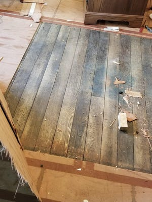 The hardwood floor was protected for years by plywood underlayment and carpet.
