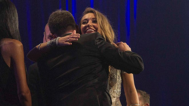 Lauren Daigle gets a hug after winning at the 46th Annual GMA Dove Awards on Tuesday Oct. 13, 2015, in Nashville.