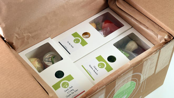 Ingredients for each HelloFresh recipe are neatly packaged in an insulated box.