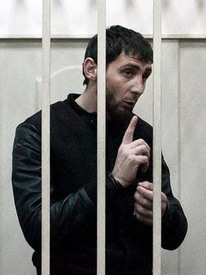 Zaur Dadayev, charged with the murder of Russian opposition figure Boris Nemtsov, speaks inside a defendant's cage at the Basmanny district court in Moscow on March 8, 2015.