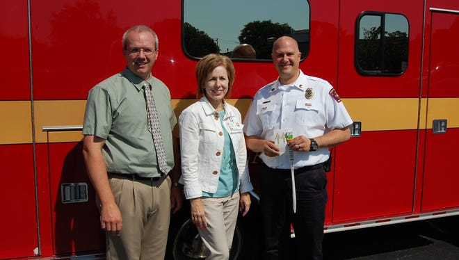 The Agnesian HealthCare Foundation has donated funds to provide mass casualty waterproof medical tags for 19 different first responder and EMS services in Fond du Lac County. Michelle Ries (center), Agnesian HealthCare Foundation events coordinator, is shown with Nathan Larsen (left), MD, St. Agnes Hospital Emergency Department and Fond du Lac EMS medical director, and Todd Janquart, Fond du Lac Area EMS Association vice president.
