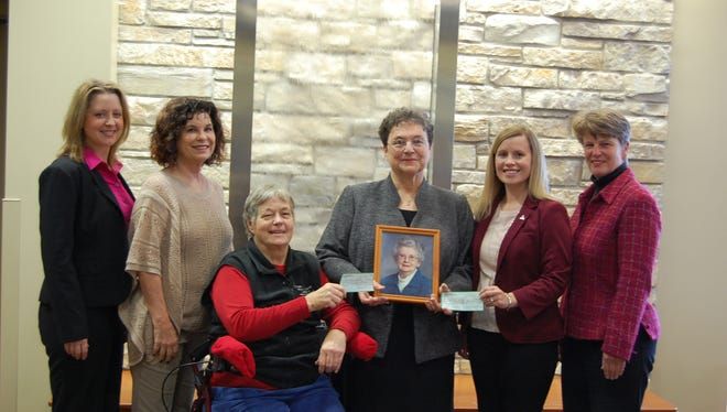 Judy DeWar (holding photo) presents estate gifts from her cousin, Ruth Birge, who passed away in January 2015. Judy is joined by (left to right) Katherine Vergos, Ripon Medical Center (RMC) chief operating officer; Joann Strandell, The Foundation for RMC Board of Directors member; Dr. Jean Johnson, The Foundation for RMC Board of Directors president; Michelle Lippart, Ripon College associate director of development; and Joan Karsten, RMC Board of Directors chairperson.