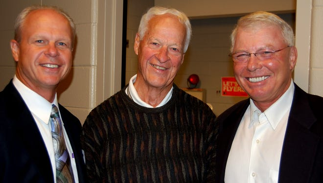 Former Flyers defenseman Mark Howe, right, would bring his father Gordie, center, around to the Flyers press box. They are seen here with Bob Clarke, right.