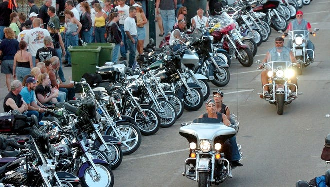 -  -Main Street Sturgis is packed Saturday evening as dusk falls on the 64th Annual Sturgis Motorcycle Rally. (Christopher Gannon/Argus Leader)