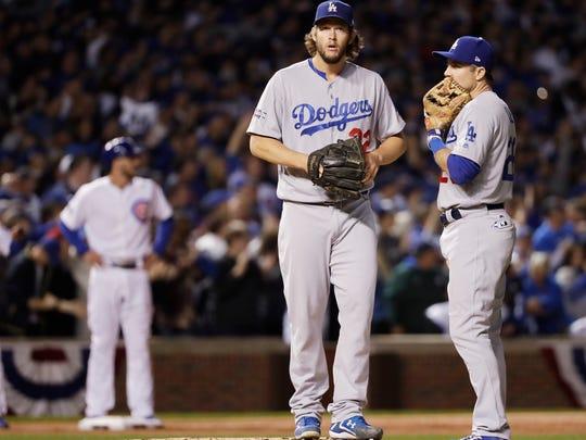 Dodgers ace Clayton Kershaw, center, has struggled in postseason elimination games.