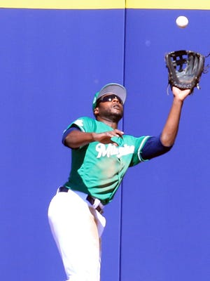 The Brewers' Lorenzo Cain makes a catch at the warning track against the Rockies on Saturday.