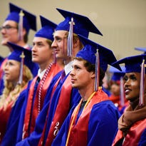 Apollo High School graduating seniors watch their classmates enter during graduation Friday, May 27, at the River's Edge Convention Center.