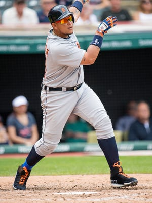 Detroit Tigers' Miguel Cabrera watches his ball after hitting a two-RBI single off Cleveland Indians starting pitcher Josh Tomlin in the fifth inning.