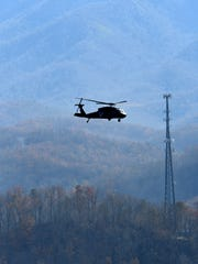 An Army National Guard helicopter flies over Gatlinburg on Dec. 1, 2016, searching for problems after the devastating fires three days before.