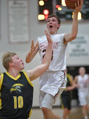 Justin Bartol (23) of Berlin takes a shot while guarded by Own Thuene (10) of Waupun. The Berlin Indians hosted the Waupun Warriors Jan. 12, 2017, at Berlin High School.