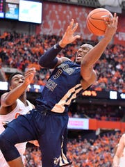 Mar 4, 2017; Syracuse, NY, USA; Georgia Tech Yellow Jackets guard Josh Okogie (5) puts up a shot as Syracuse Orange guard Tyus Battle (25) defends during the first half of a game at the Carrier Dome. Mandatory Credit: Mark Konezny-USA TODAY Sports
