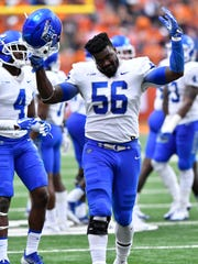 MTSU defensive end Walter Brady (56) taunts the crowd after being ejected for a targeting penalty by roughing the passer during the third quarter Sept. 9, 2017, against Syracuse at the Carrier Dome.