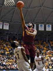 Jan 11, 2017; Wichita, KS, USA;  Loyola-Chicago Ramblers forward Aundre Jackson (24) drives to the basket over Wichita State Shockers guard Daishon Smith (2) during the second half at Charles Koch Arena.