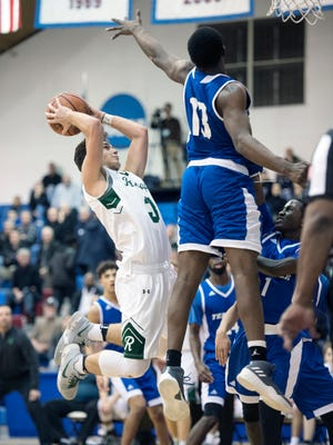 Ramapo and Teaneck in the Bergen County Jamboree boys basketball tournament quarterfinal at the FDU Rothman Center in Hackensack on Friday, February 9, 2018. R #3 Jason Oppler drives to the basket in the fourth quarter.