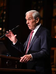 Former U.S. Rep. Ron Paul speaks to guests during the