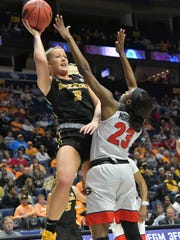 Missouri Tigers guard Sophie Cunningham (3) shoots against Georgia Bulldogs guard Gabby Connally (23) during the first half of game ten at Bridgestone Arena on March 2 in Nashville.