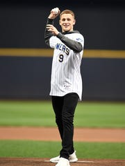 Donte DiVincenzo gets ready to throw out the first pitch.