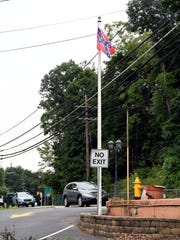 A Confederate battle flag in front of the shuttered Paris Inn on Alps Road in Wayne on Monday. The flag was replaced by an American flag on Tuesday.