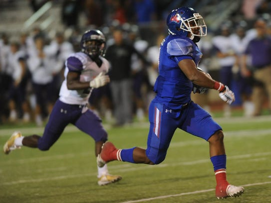 Cooper's Tyrees Whitfield, right, runs for his second