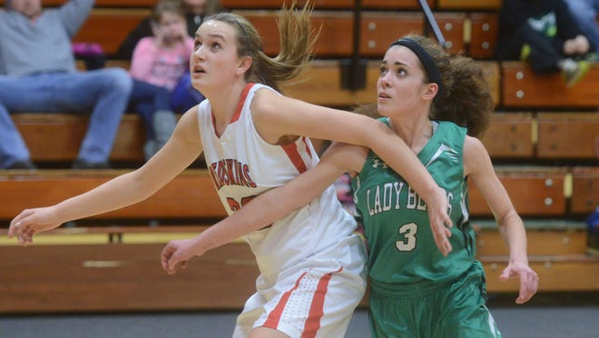 Port Clinton's Sydney Alexander and Margaretta's Rebecca Denman battle for position under the hoop as they look for a rebound during a basketball game on Tuesday, Jan 13, 2015.