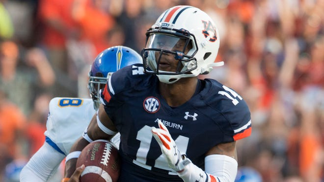 Auburn quarterback Nick Marshall leads the Tigers against Jake Waters and Kansas State tonight.