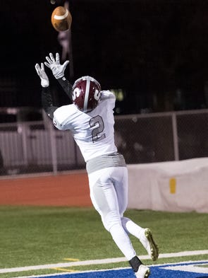 State College's Noah Woods (2) catches a pass and scores