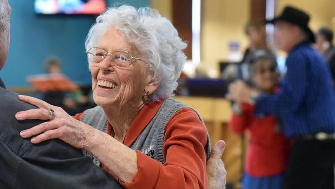Rhoda Bowser dances to the music of the band Country Sunshine during a Jan. 7, 2016, performance by the band at the Bonnie Dallas Senior Center in Farmington.