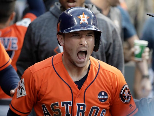 Houston Astros' Alex Bregman reacts after scoring during