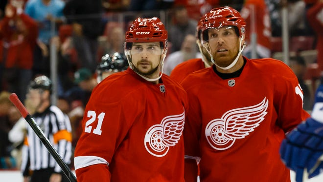 Detroit Red Wings center Brad Richards (right) receives congratulations from left wing Tomas Tatar (left) after scoring during a preseason game.