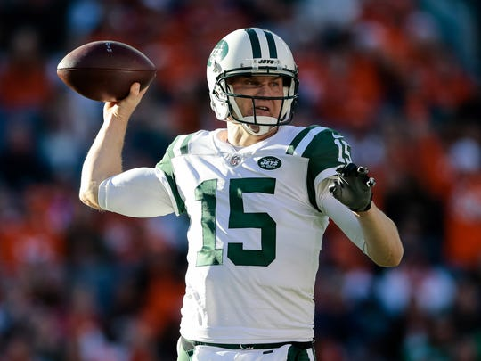 New York Jets quarterback Josh McCown (15) drops back to pass in the second quarter against the New York Jets at Sports Authority Field at Mile High on Dec. 10, 2017.